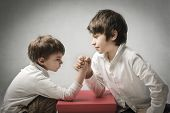 Children playing arm wrestling