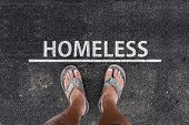 Homeless. Man With Dirty Feet In Slippers Is Standing On Asphalt Next To Line And Word Homeless poster