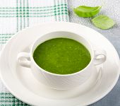 The Concept Of A Healthy, Vegetarian Or Dietary Food: Cream Spinach Soup, With Pine Nuts And Basil.  poster