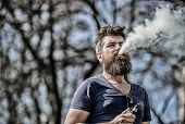 Stress Relief Concept. Bearded Man Smoking Vape. Smoking Electronic Cigarette. Man Long Beard Relaxe poster