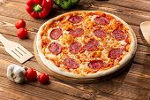 Delicious Hot Homemade Pepperoni Pizza On The Wooden Table. Pepperoni Pizza - Fresh Homemade Pizza W poster