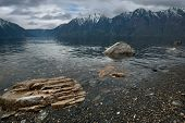 Russia. The South Of Western Siberia. Mountain Altai. Late Spring On The Shore Of Lake Teletskoye. poster