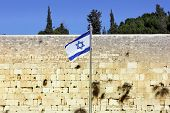 stock photo of israel israeli jew jewish  - Israeli flag at the Western Wall - JPG