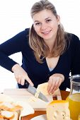 Happy Woman Cutting Cheese