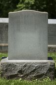 stock photo of tombstone  - A blank tombstone stands silently in a peaceful cemetery - JPG