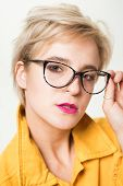 Stylish Girl With Eyeglasses. Eyesight And Eye Health. Good Vision. High Quality Lens. Fashionable E poster