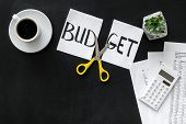 Budget Reduce Concept With Accounting, Sciccors And Paper With Cut Word Budget On Black Background T poster