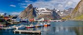 Hamnoy Village on the Lofoten Islands, Reinefjord,  Norway. Panoramic Shot,  Fishing boats in harbo poster