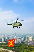 Helicopter With Military Flag Over Moscow At Parade Of Victory Day