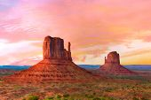 Beautiful sunset over the West and East Mitten Butte in Monument Valley. Utah, USA poster