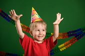 image of party hats  - A photo of a boy on a birthday party - JPG