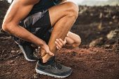 Achilles Injury On Running Outdoors. Man Holding Achilles Tendon By Hands Close-up And Suffering Wit poster