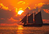 Boat Sailing In Front Of A Key West Sunset