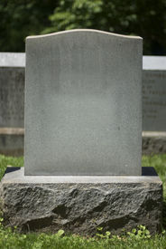 picture of tombstone  - A blank tombstone stands silently in a peaceful cemetery - JPG