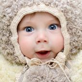 cute funny infant boy like a bear, beautiful kid's portrait closeup