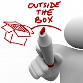 A man, person or guy writes the words Outside the Box with a red pen or marker next to an illustration of a box