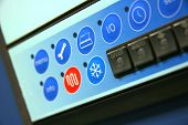 pic of air conditioner  - Industrial air conditioner controls detail focus on cooling symbol