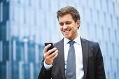 Handsome businessman using a smartphone