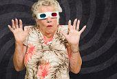 Afraid Senior Woman Watching 3d Movie On Wallpaper