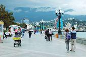 Tourists Walking Along Seafront Of Yalta City, Ukraine