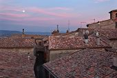 Full moon and red-tiled terracotta rooftops, Umbria