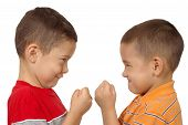 image of crew cut  - two boys aged 5 and 6 years with fists raised get ready to have a fight isolated over white background - JPG