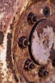 Rusty Hub Of Tractor Wheel - Vertical Format