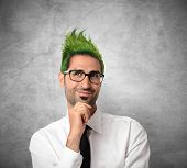 stock photo of exaltation  - Concept of creative businessman with green hair - JPG