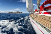 image of sailing vessel  - Yacht Sailing boat in the sea of Sardinia Italy - JPG