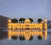 Rajasthan landmark - Jal Mahal (Water Palace) on Man Sagar Lake on sunset.  Jaipur, Rajasthan, India
