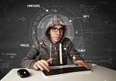 pic of personal safety  - Young hacker in futuristic enviroment hacking personal information on tech background - JPG