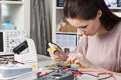 Girl in radio electronics lab