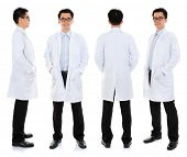 Full body Asian male beauty therapist in beautician uniform with confident smile, standing in differ