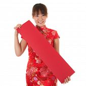 Asian woman with Chinese traditional dress cheongsam or qipao holding couplet, Isolated on white bac