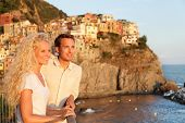 Romantic couple in love by sunset on holidays travel. Young beautiful couple enjoying ocean view rom