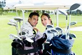 Couple in a golf cart looking very happy