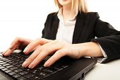 Woman hands typing on laptot, close-up, isolated
