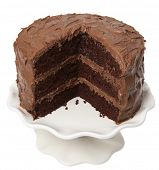 Chocolate cake with piece take out, on white background