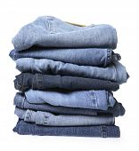 stock photo of blue things  - Stack of blue jeans on white background - JPG