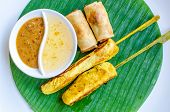 Vegetables Spring Roll And Chicken Satay