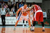 KAPOSVAR, HUNGARY - MARCH 8: Hrvoje Puljko (white 7) in action at a Hungarian Championship basketbal