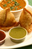 stock photo of bengal-gram  - Samosa is an Indain fried or baked pastry with a savory filling with spiced potatoes onions peas lentilsChana - JPG