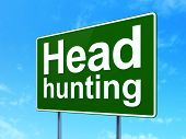 Business concept: Head Hunting on road sign background