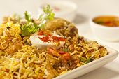 stock photo of raita  - Front Close up View of  Hot delicious chicken biryani.