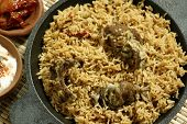 stock photo of biryani  - Mutton Gosht Biryani - Lamb, hogget, and mutton are the meat of domestic sheep or Goat. Biryani, biriani, or beriani is a set of primarily South Asian rice-based foods made with spices,rice (usually basmati) and meat/vegetables. 