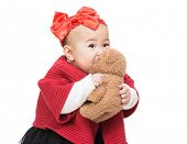 Asian baby girl play doll bear