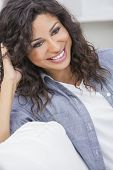 Studio portrait of a beautiful young Latina Hispanic woman smiling