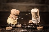 stock photo of midget  - Concept Sumo wrestling with wine cork figures - JPG