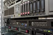 picture of raid  - servers stack with hard drives in a datacenter for backup and data storage - JPG