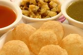 Pani puri is a popular street snack of India